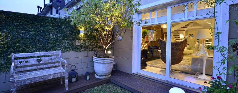 Jardines de estilo moderno por Tania Bertolucci  de Souza     Arquitetos Associados