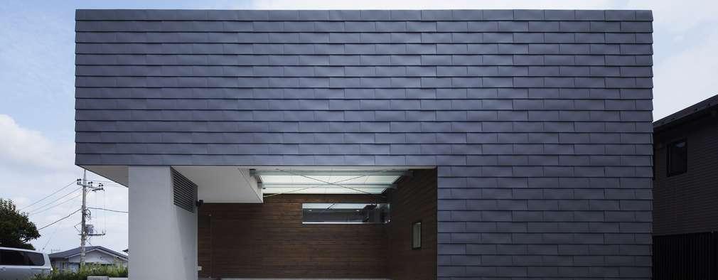 AY 庭とパティオのある家: 山縣洋建築設計事務所が手掛けた家です。