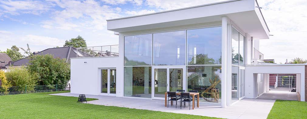 Projekty, nowoczesne Domy zaprojektowane przez Immotionelles