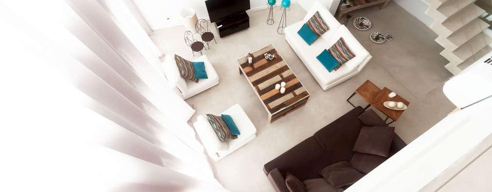 Salas de estilo moderno por Estudio Arqt