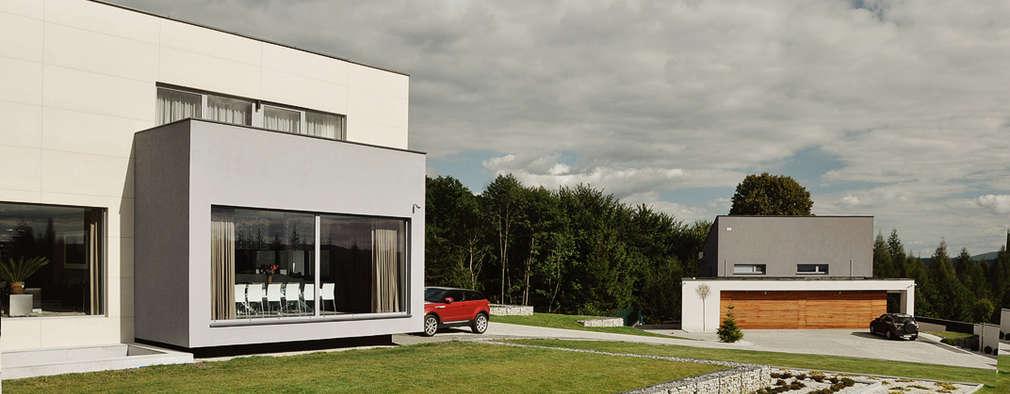 DOM ZI: styl nowoczesne, w kategorii Domy zaprojektowany przez MACIEJ JANECZEK ARCHITEKT