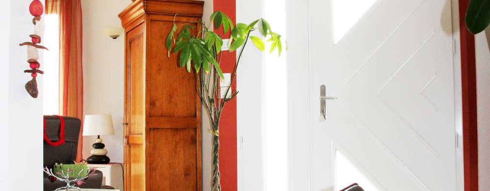 Entrée après travaux: Couloir et hall d'entrée de style  par Uniq intérieurs