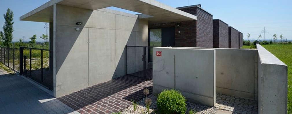 Casas de estilo minimalista por MARKÉTA CAJTHAMLOVÁ, ARCHITEKTONICKÁ PROJEKČNÍ KANCELÁŘ