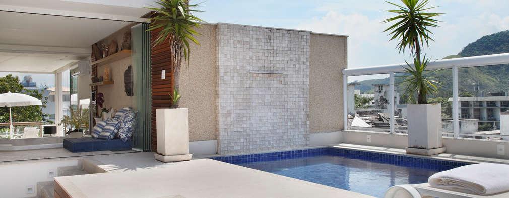 สระว่ายน้ำ by Carolina Mendonça Projetos de Arquitetura e Interiores LTDA