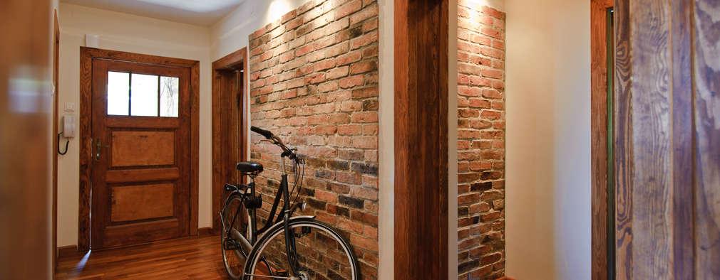 Pasillos y hall de entrada de estilo  por IMPAST