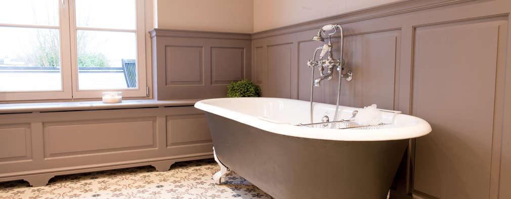 Baños de estilo colonial por Kenny&Mason