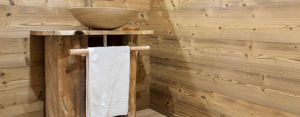 Baños de estilo rústico de RI-NOVO