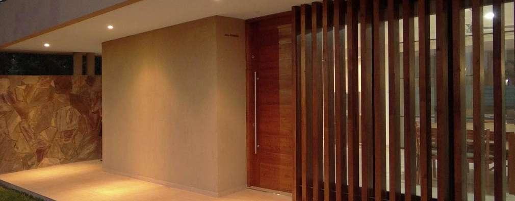 Maisons de style de style Moderne par D'Odorico Arquitectura & Obras