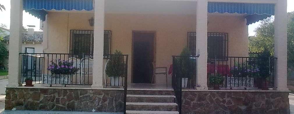 casa del porche de piedra de estilo de llibers salvador arquitectos