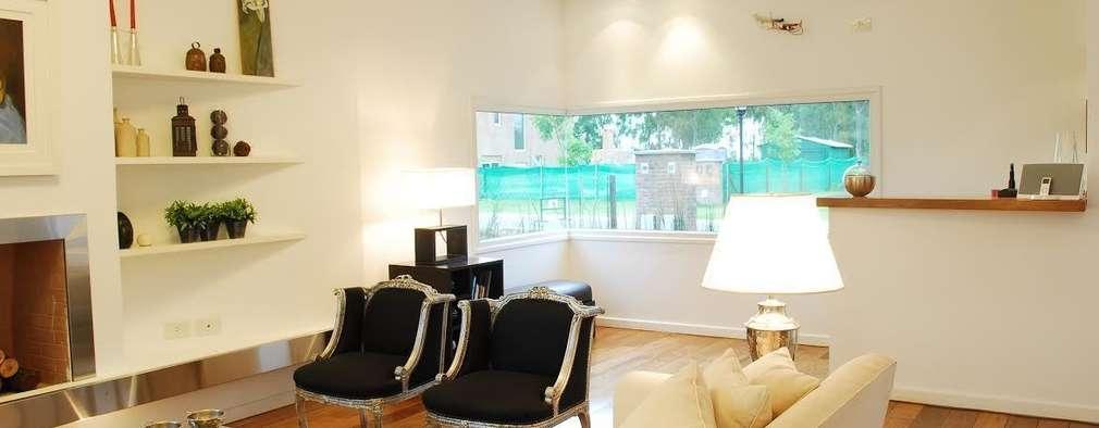 Salas / recibidores de estilo moderno por Estudio de Arquitectura Clariá & Clariá