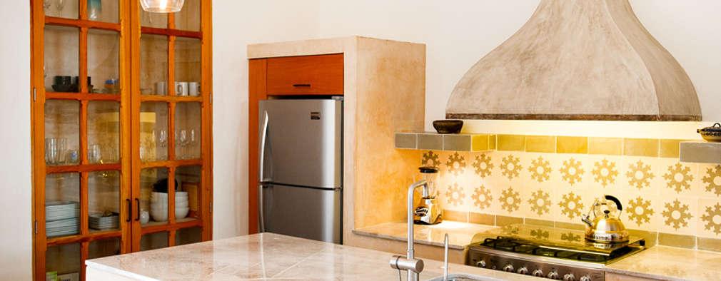 Cocinas de estilo ecléctico por Taller Estilo Arquitectura