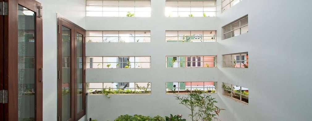 Jardines de estilo moderno por Muraliarchitects