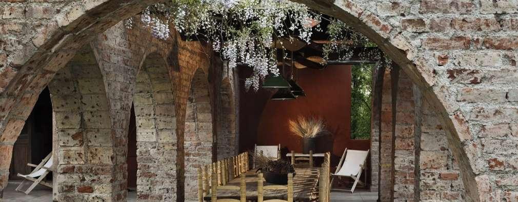 Chalet Atamisque: Jardines de invierno de estilo rústico por Bórmida & Yanzón arquitectos