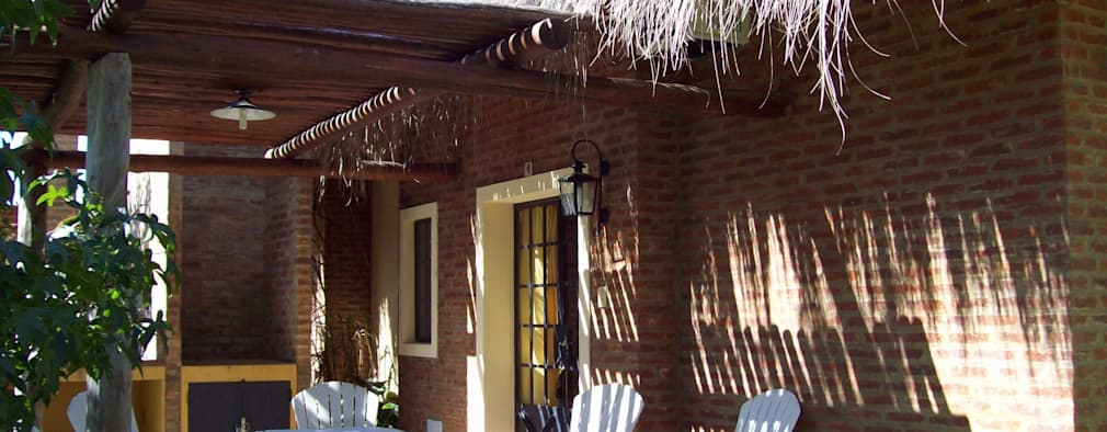Hoteles de estilo  por D'ODORICO OFICINA DE ARQUITECTURA