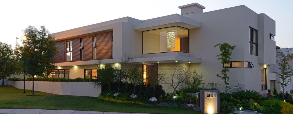 modern Houses by VICTORIA PLASENCIA INTERIORISMO