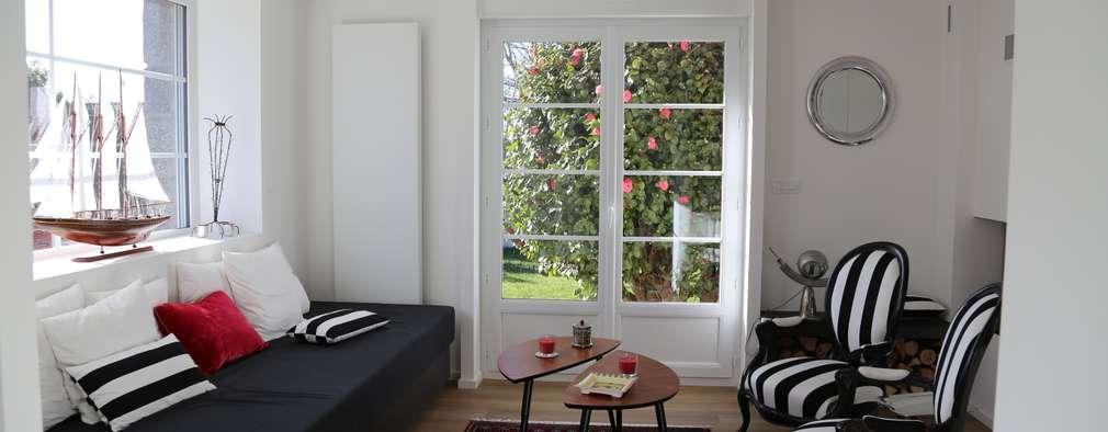 Salas de estilo moderno por Ad Hoc Concept architecture