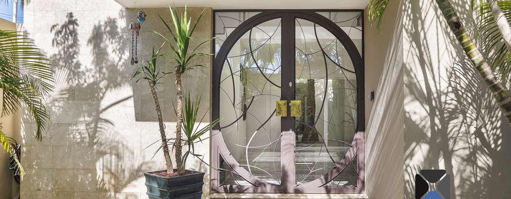 Casas de estilo ecléctico por PORTO Arquitectura + Diseño de Interiores