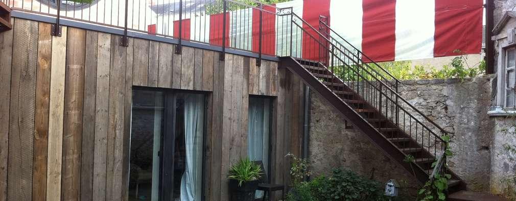 Jardin interieur en plein centre ville:  de style  par Tabary Le Lay