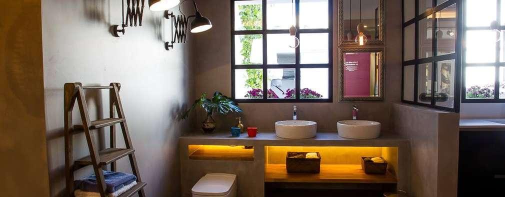 Baños de estilo industrial por CONTRACT SOLUTIONS
