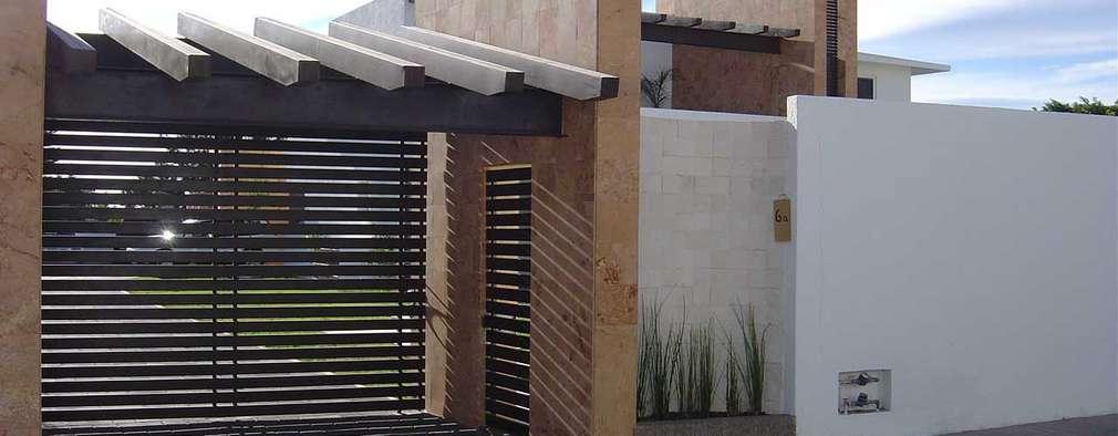 10 puertas de garajes especialmente para casas modernas for Fachadas de garajes modernos