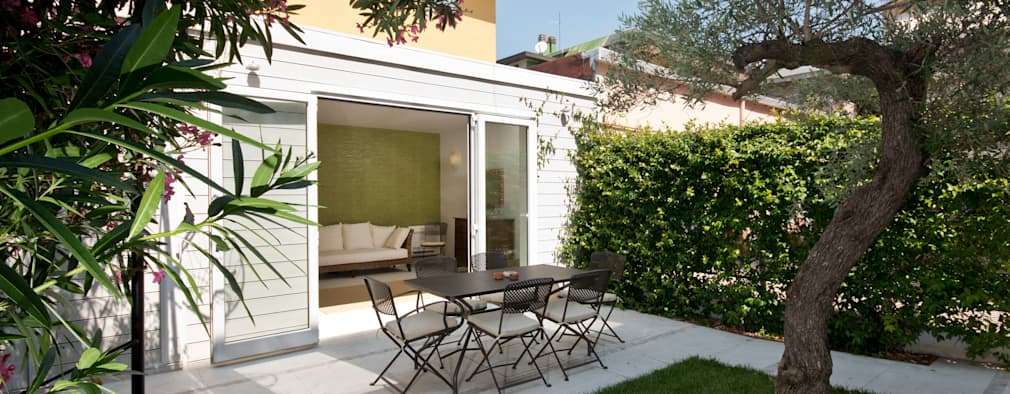 Jardines de estilo ecléctico por bilune studio