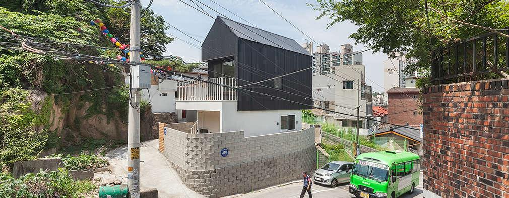 Casas de estilo moderno por OBBA