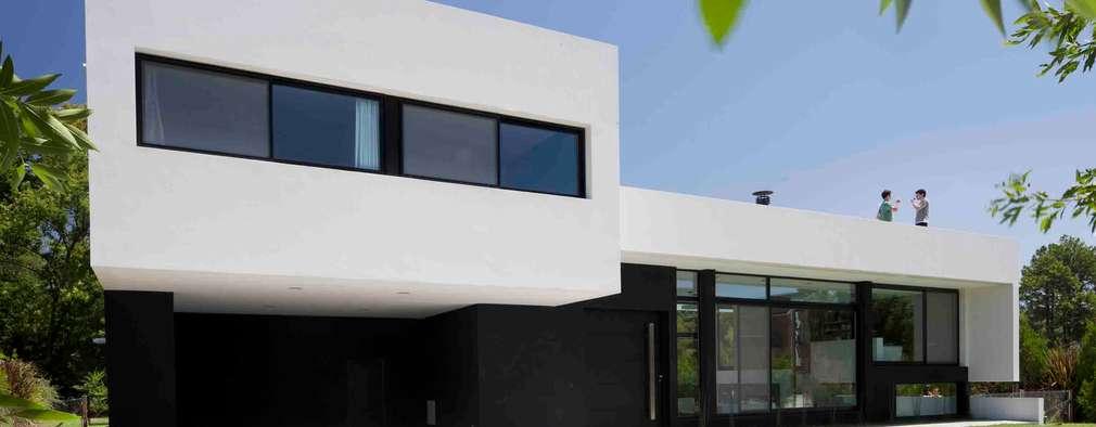 Casas de estilo moderno por Remy Arquitectos