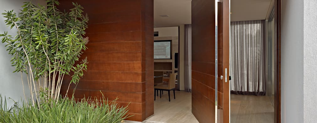 Projekty, nowoczesne Domy zaprojektowane przez Márcia Carvalhaes Arquitetura LTDA.