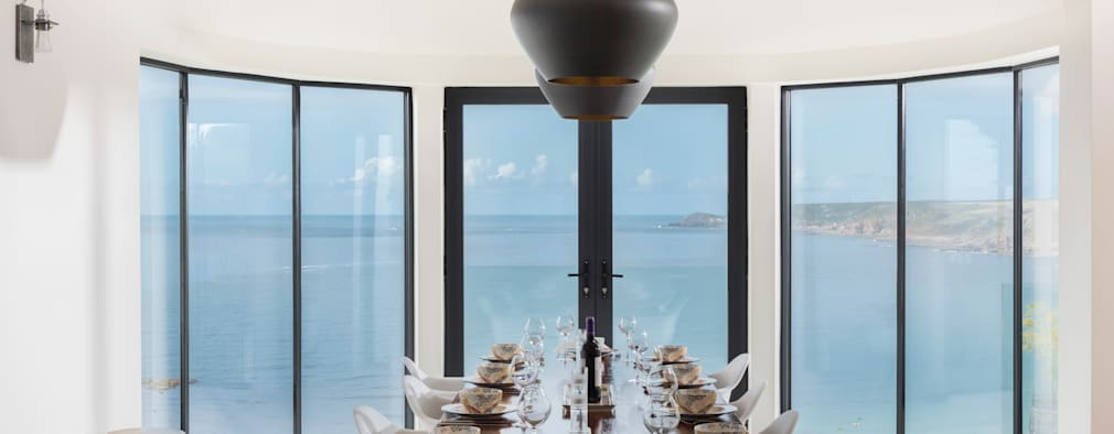 Comedores de estilo moderno por Laurence Associates
