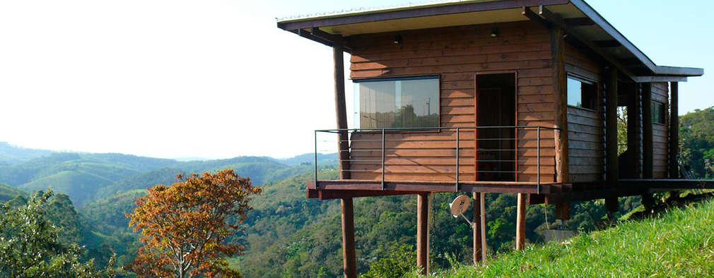 6 casas de madera perfectas para una escapada a la selva for Viviendas sobre terrazas