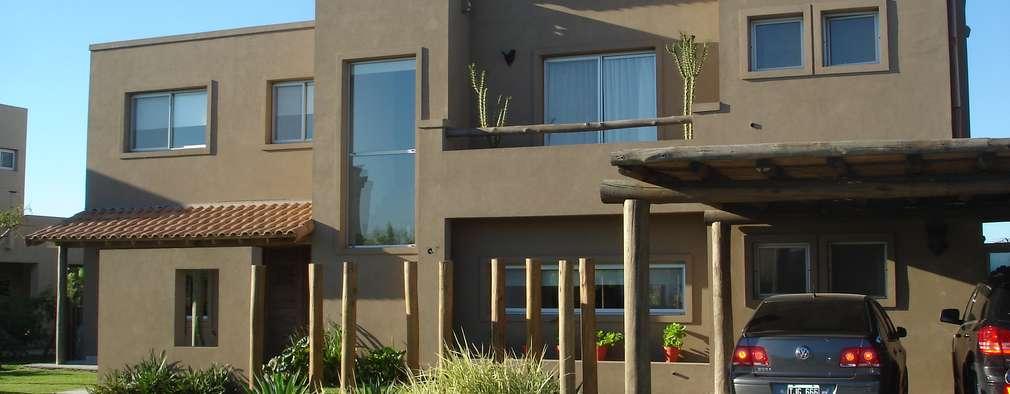 Casas de estilo rústico por Fainzilber Arqts.