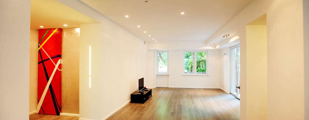 Salas de estilo moderno por studio AGILE
