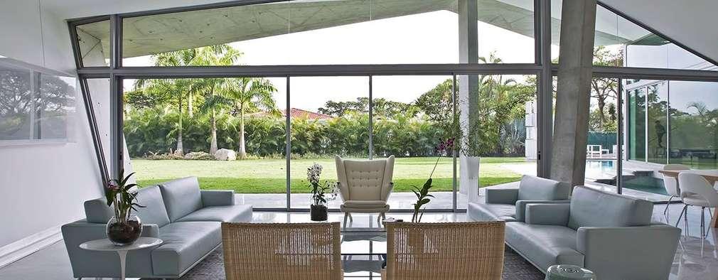 Casa AG: Salas / recibidores de estilo moderno por oda - oficina de arquitectura