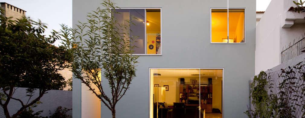 Casa na Ajuda: Habitações  por EXTRASTUDIO