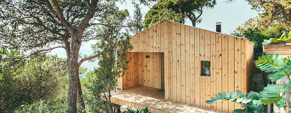 Casas de estilo moderno por dom arquitectura