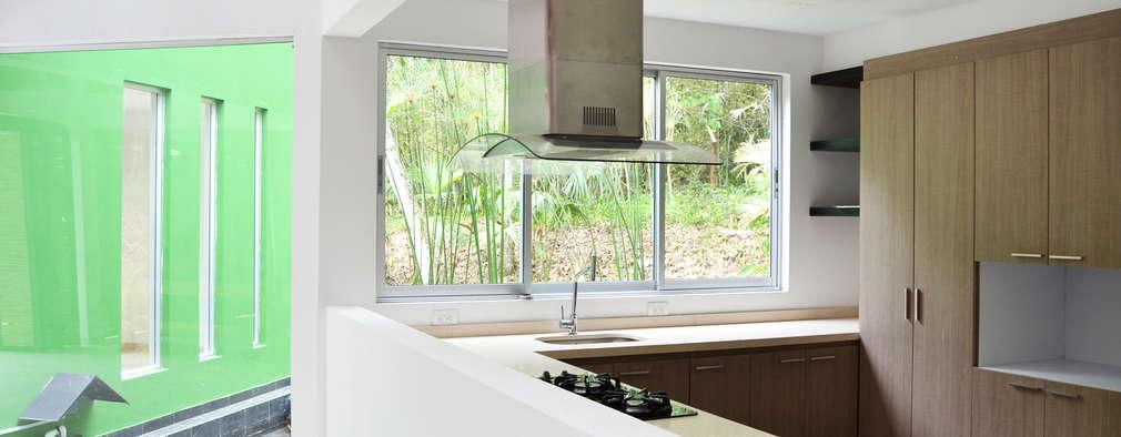 Cocinas de estilo minimalista por santiago dussan architecture & Interior design