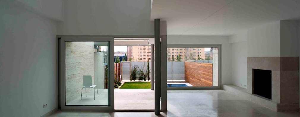 Salas / recibidores de estilo moderno por Cano y Escario Arquitectura