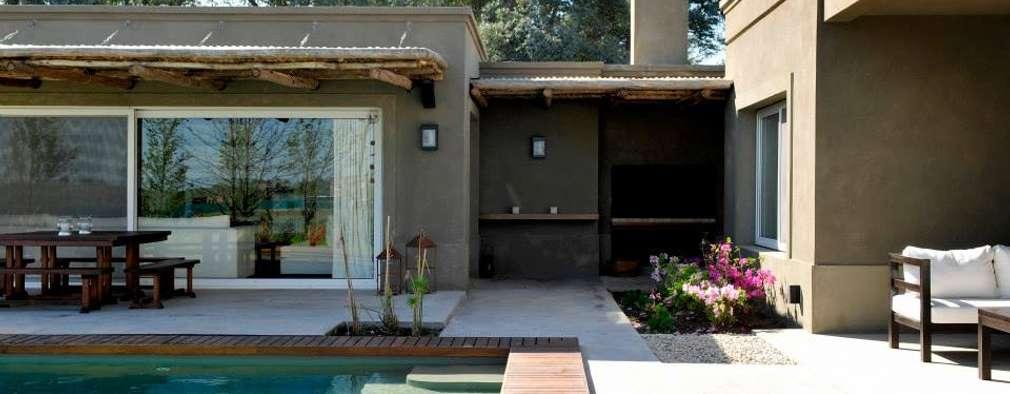 Casa en Pilará: Piletas de estilo moderno por Aulet & Yaregui Arquitectos