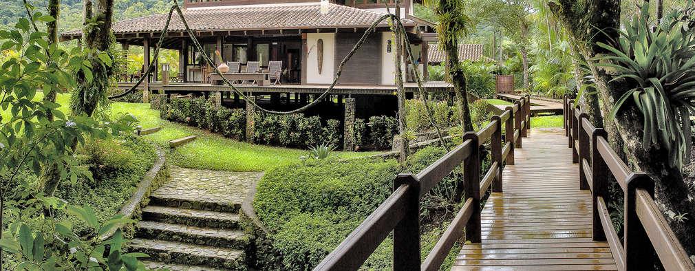 Casas de estilo topical por Mellani Fotografias