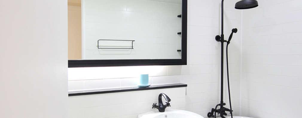거실 욕실: 로하디자인의  화장실