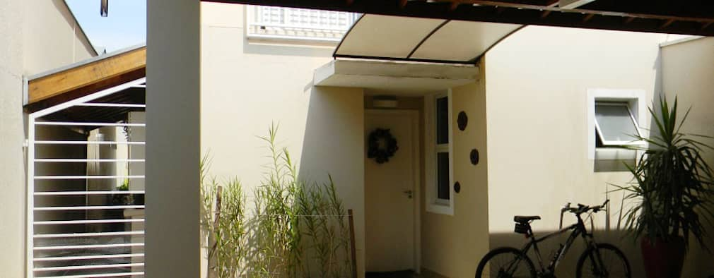 Casas de estilo  por THACO. Arquitetura e Ambientes