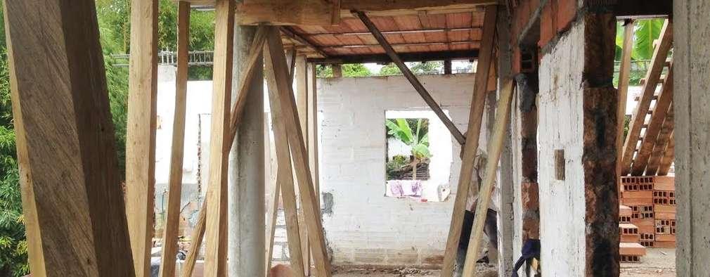 Salas de estilo rural por NIVEL SUPERIOR taller de arquitectura