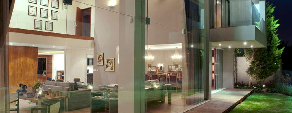 Casa LC: Jardines de estilo moderno por ARCO Arquitectura Contemporánea
