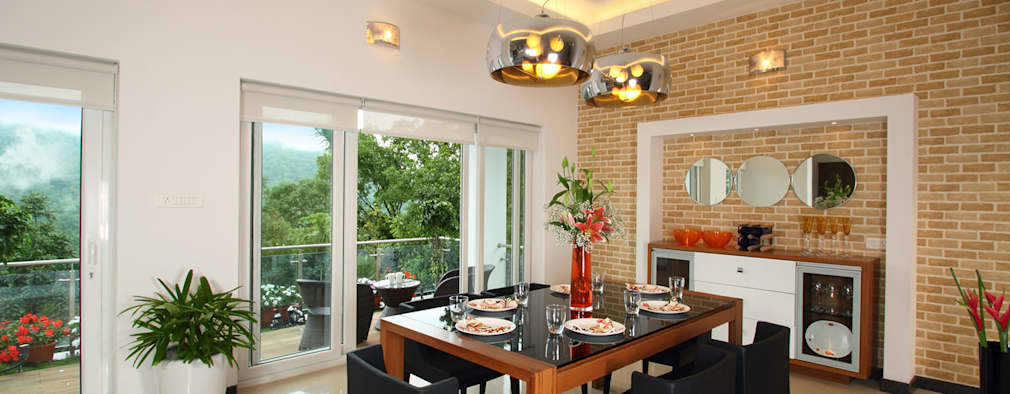 Comedores de estilo moderno por Savio and Rupa Interior Concepts