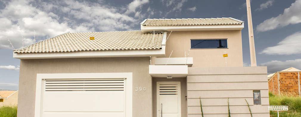 Casas de estilo moderno por Arch & Design Studio