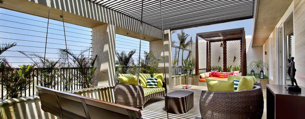 Nikhil patel residence:  Terrace by Dipen Gada & Associates