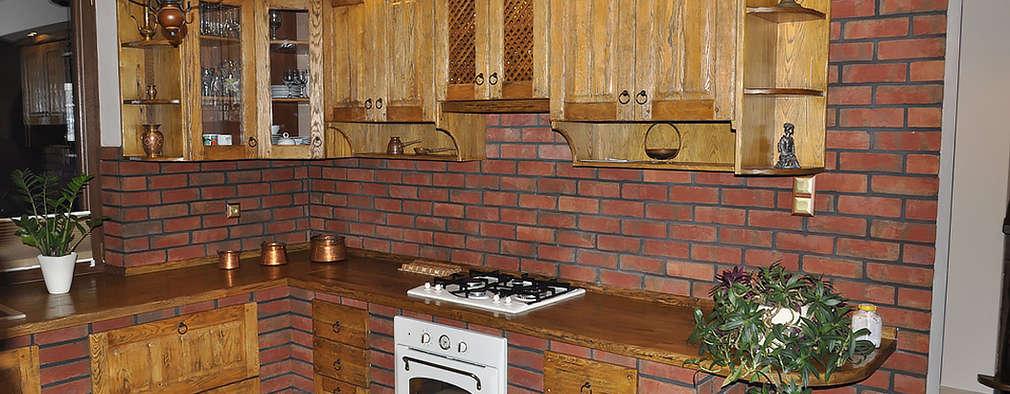 rustic Kitchen by Revia Meble i drzwi z litego dębu.