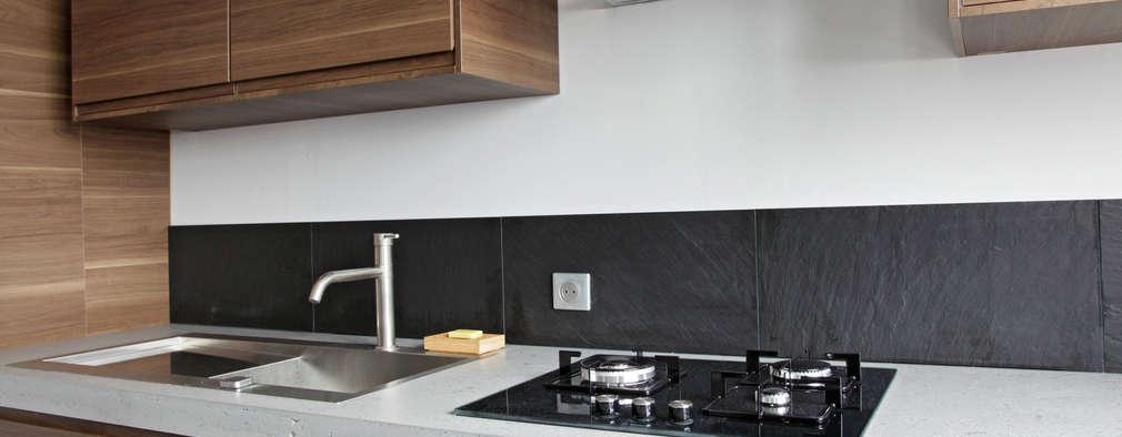 Cocinas de estilo moderno por Concrete LCDA