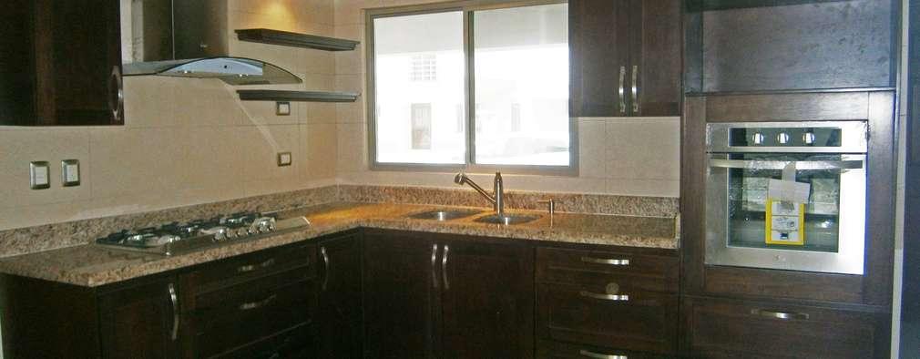 Cocinas de estilo moderno por H-abitat Diseño & Interiores