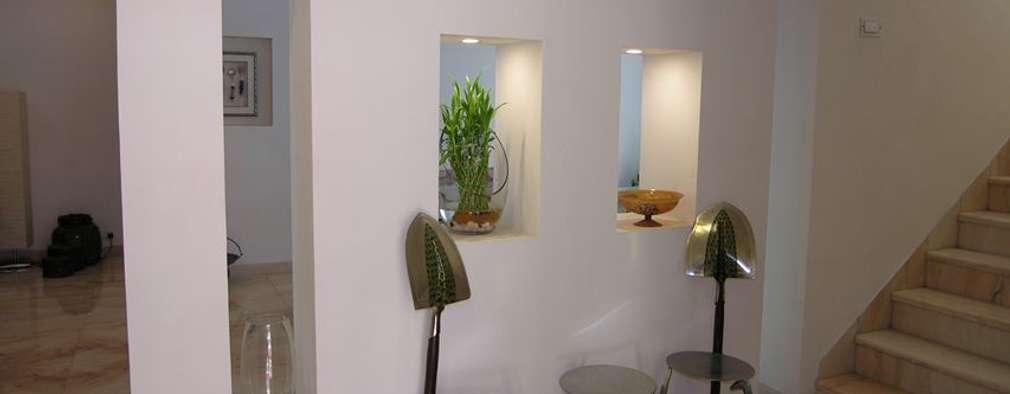 Salas / recibidores de estilo moderno por Ansari Architects